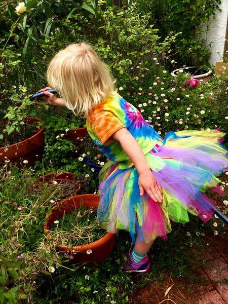 Fairy Fairy Girl Little Blonde Girl Blond Hair Garden Girl Watering Container Garden Tutu Colorful Outdoors Foilage Overgrown Tie Dye Hose Exceptional Photographs EyeEm Best Shots in Santa Rosa California