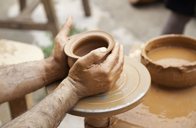 Human Hand Hand One Person Human Body Part Real People Pottery Focus On Foreground Holding Occupation Art And Craft Skill  Working Clay Craft Making Expertise Men Creativity Indoors  Preparation  Finger