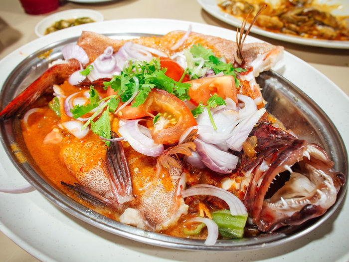 Close-up of fish served in plate on table