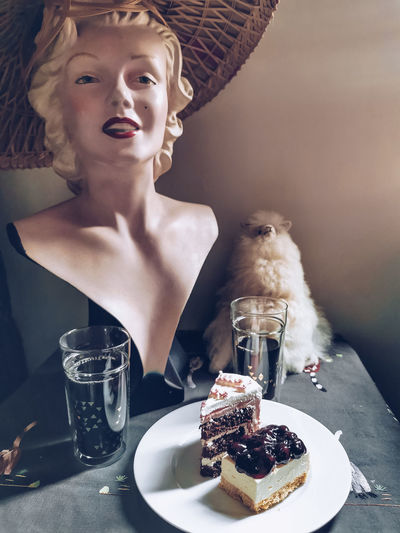 Midsection of woman with ice cream in plate on table