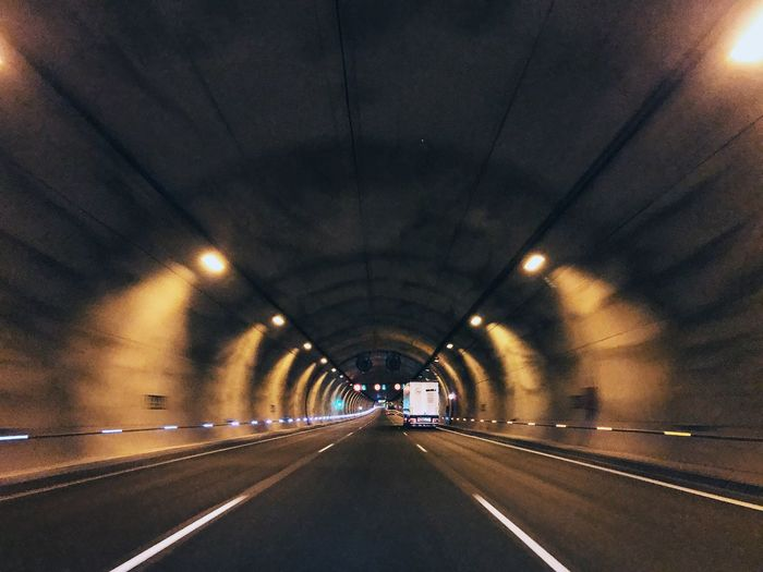 Road in illuminated tunnel