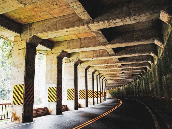 Empty road under bridge