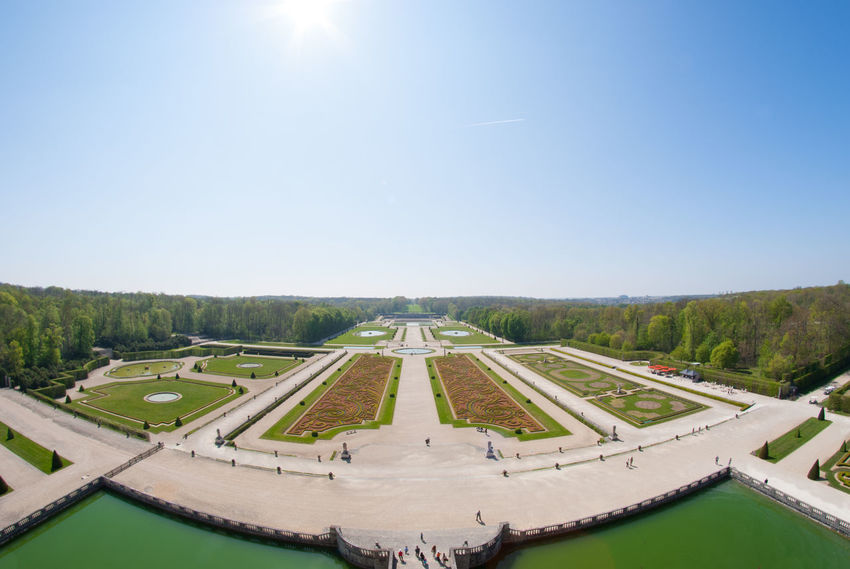 The Beautiful View Of The Garden Inside The Chateau De Vaux Le Vicomte Looking From It's Tallest Structures. The House Is A Baroque French Chateau Located In Maincy, Near Melun, Southeast Of Paris. Architecture Beautiful Château Clear Sky Day Europe France History Architecture Holiday Maincy Melun Nature No People Outdoors Paris Scenics Sky Structure Sunlight Tourism Travel Destinations Tree Vicomte Water Your Ticket To Europe