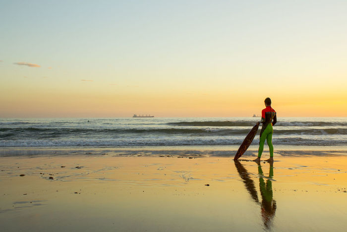 Full Length One Person Sunset Beach Sea Nature People Cascais E Estoril Outdoors Adult Standing One Man Only Horizon Over Water Water Only Men Occupation Beauty In Nature Photographer Day Nice Day Real People Surf Board Radical Sport Lisbon - Portugal
