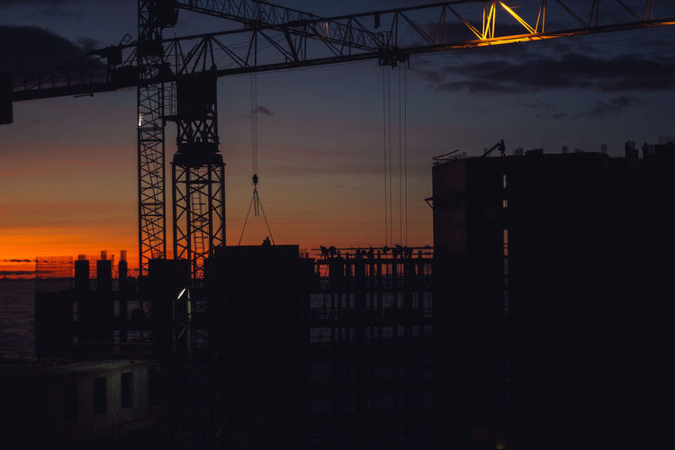 Sunset Sky Architecture Silhouette Orange Color Industry Built Structure Cloud - Sky Water No People Machinery Nature Development Crane - Construction Machinery Sea Construction Site Construction Industry Outdoors Building Exterior Construction Equipment