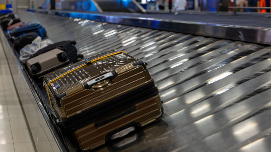 High angle view of suitcases on conveyor belt
