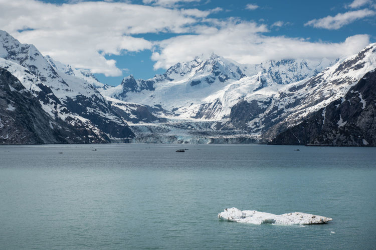Glaciers, water, and mountains near glacier bay, alaska Beauty In Nature Cold Temperature Day Floating On Water Frozen Glacial Glacier Ice Iceberg Lake Mountain Mountain Range Nature No People Outdoors Scenery Scenics Sky Snow Snowcapped Mountain Tranquil Scene Tranquility Water Waterfront Winter