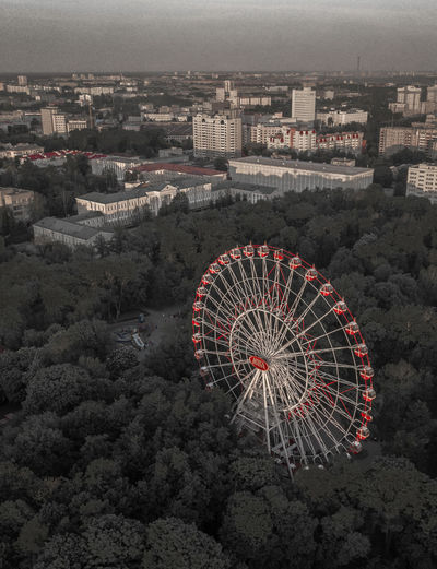 Ferriswheel in Minsk City Architecture Building Exterior Built Structure High Angle View Cityscape Nature Ferris Wheel Amusement Park Ride Amusement Park Arts Culture And Entertainment Crowd Day Building Residential District Sky Outdoors Crowded Geometric Shape Minsk Belrus Ferriswheel Aerial View