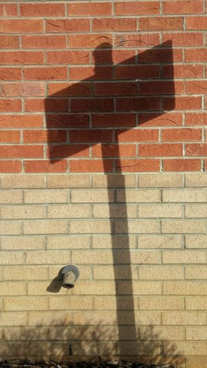 Shadow Light Design Outdoors Stone Brick Signs Pipe Architecture Built Structure