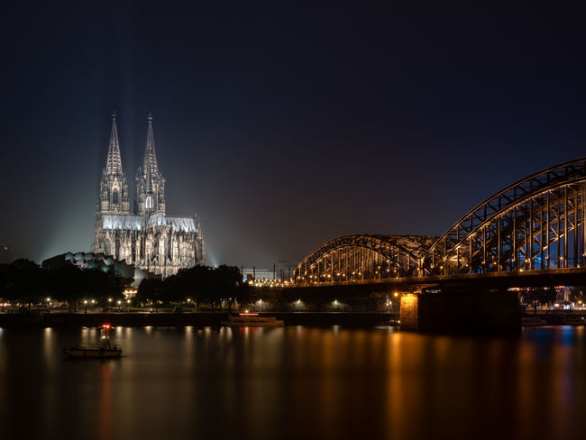 A dense fog drowned out all buildings behind the Cologne Cathedral that night, giving the city's perhaps two most prominent buildings even more attention. Architecture Cityscape Cologne Köln Kölner Dom Night Lights Nightphotography Rhein Rhine Travel City Lights Cologne Cathedral Fog Germany Haze Hohenzollernbridge Hohenzollernbrücke Long Exposure Mist River Slow Shutter