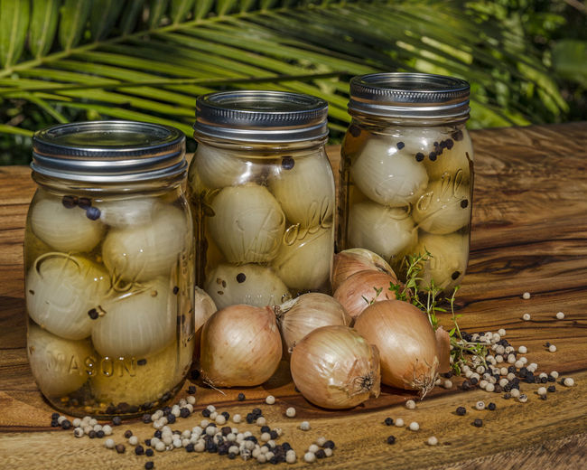 close-up of onions in jar on table Food And Drink Close-up Food Freshness Healthy Eating Ingredient Jar No People Onion Preserving Spice Table Vegetable