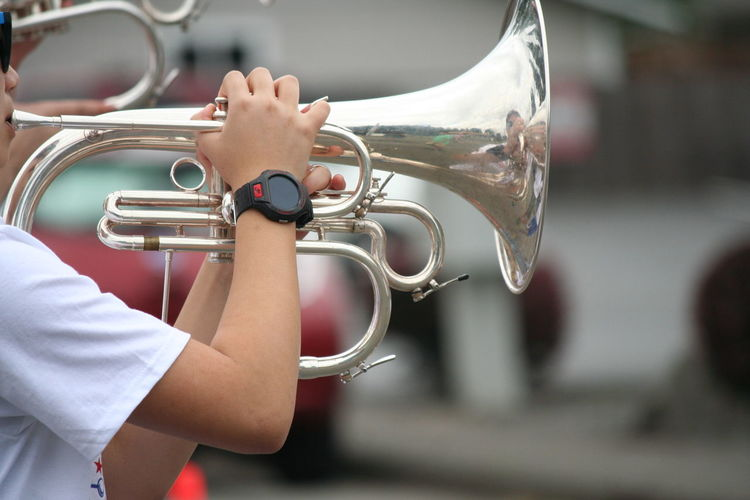 Person playing cornet on fourth of july independence day parade