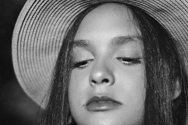 Nowhere, 2018 Hat Adult Beautiful Woman Black And White Body Part Close-up Contemplation Focus On Foreground Front View Hair Hairstyle Hat Headshot Human Body Part Human Face Human Hair Leisure Activity Lifestyles One Person Portrait Real People Teenager Women Young Adult Young Women The Portraitist - 2018 EyeEm Awards