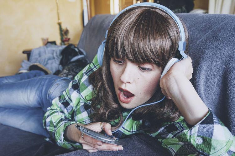 Portrait of teenage girl using mobile phone