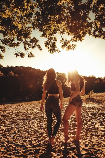 Jeans Models Summertime Adult Adults Only Beach Bonding Day Friendship Full Length Hotpants Leisure Activity Nature Outdoors People Real People Sky Standing Summervibes Sunset Togetherness Tree Vacations Young Adult Young Women