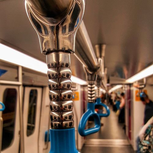Close-up of handles in train
