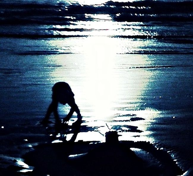 My son in Canon Beach Oregon Sunset Silhouettes