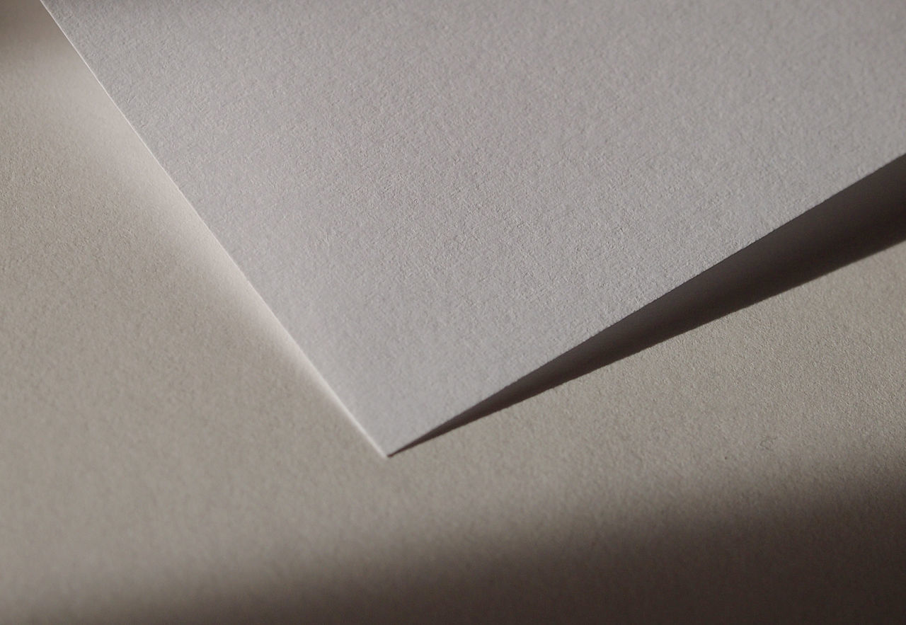 paper, close-up, indoors, no people, shadow, copy space, high angle view, still life, white color, backgrounds, full frame, textured, wall - building feature, blank, pattern, sunlight, simplicity, single object, detail, gray, ceiling