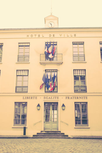 Hotel de Ville, Saint-Germain-en-Laye Building Exterior Architecture Built Structure Building Window City No People Day Sky Outdoors Residential District Communication Façade Nature Low Angle View Text Wall Hanging Entrance Wall - Building Feature Flag Flags Red White And Blue France Europe Town Hall Hôtel De Ville Old