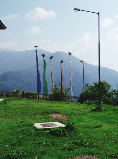 Prayer flags with beautiful clear sky & green valley behind it! I Love Nature! Taking Photos
