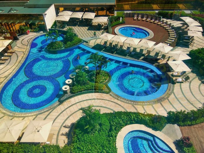 A million dollar view from our room.. CityofdreamsManila Crowntowerresort Pool Milliondollarview Staycation Facilities Luxury Wanderlust Blue Day Outdoors