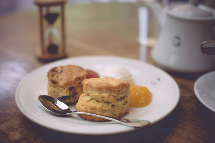 Close-Up Of Scones In Plate On Table