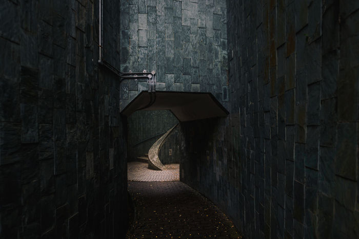 Way to spiral staircase with lighting. Architecture Fort Canning Park Singapore Spiral Staircase The Architect - 2018 EyeEm Awards Architecture Architecture Photography Brick Brick Wall Building Exterior Built Structure Concrete Footpath Hole Light And Shadow Outdoors Staircase Stone Wall Wall The Creative - 2018 EyeEm Awards