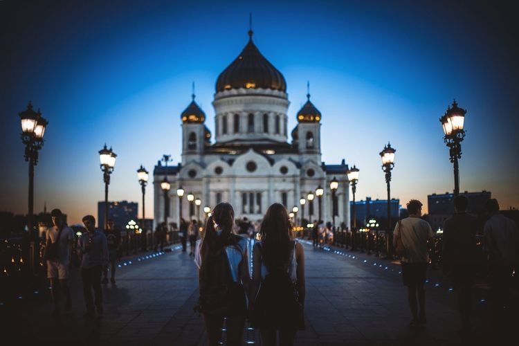 People visiting cathedral of christ the saviour against sky at dusk