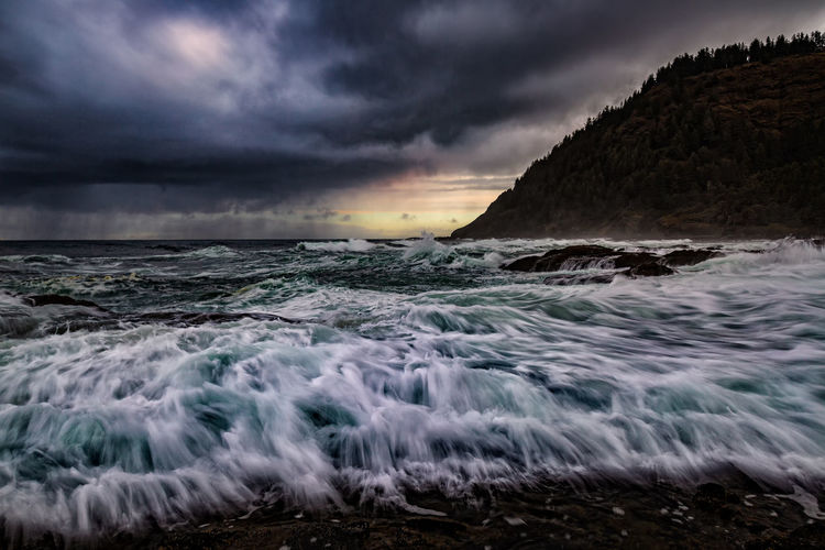 Storm on Oregon's central coast. Cloud - Sky Sky Sea Motion Water Beauty In Nature Wave Land No People Nature Sport Sunset Beach Scenics - Nature Storm Aquatic Sport Overcast Outdoors Power In Nature Oregon Thors Well Stormy Weather Ocean Pacific Seascape Wave Surf Coastal Feature Coastal Landscape Coastal_collection