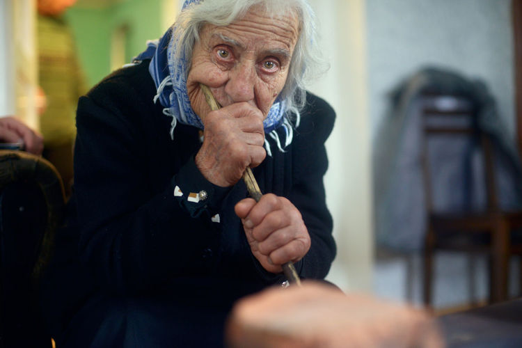 My 90 years old granny living all alone in the village of Anaga, Georgia. Gray Hair Old Woman One Person People Photo Of The Day Photojournalism Portrait Portrait Of A Woman Rural Scene Sad Senior Adult Sitting Tamar Mirianashvili Village Life Week On Eyeem Women Around The World Women Of EyeEm Women Who Inspire You The Portraitist - 2017 EyeEm Awards