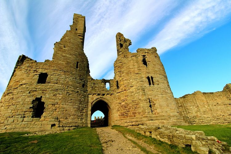 Dunstanburgh Castle Newton By The Sea Ancient Ancient Civilization Arch Archaeology Architecture Building Exterior Castle Day Deterioration Fort History Low Angle View Nature Old Old Ruin Outdoors Ruined Sky Stone Wall The Past Tourism Travel Travel Destinations