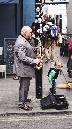 Full length of father with son standing outdoors