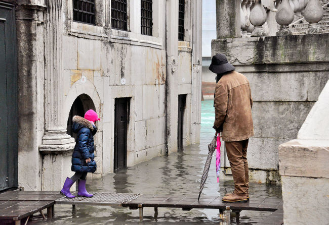 Acqua Alta Day in Venice - March 2014 Rainy Days Venice, Italy Acqua Alta Architecture Building Building Exterior Built Structure Canal Casual Clothing Child Childhood Clothing Daughter Family Father Full Length Innocence Little Girl Outdoors People Real People Togetherness Two People Water