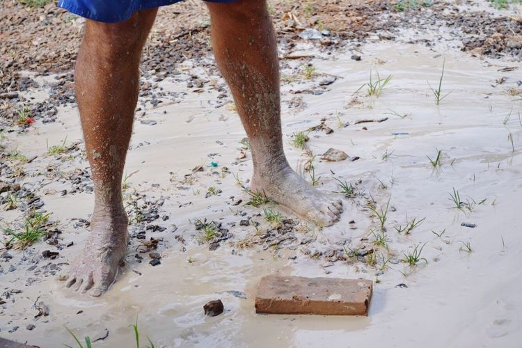 Human Leg Low Section One Person Walking Men Human Body Part Day Sand Beach Real People One Man Only Outdoors Lifestyles Only Men Standing Adults Only Adult Close-up Young Adult People Mud Muddy Waters Muddy Dirt Clay