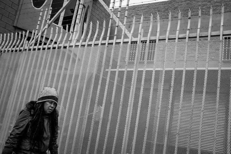 Photo444 Documentary Photography Fujix100f Fujifilm Fujifilm_xseries Blackandwhite Black And White Homeless Portrait Streetphotography Built Structure Architecture Pattern Metal Day Netting Real People