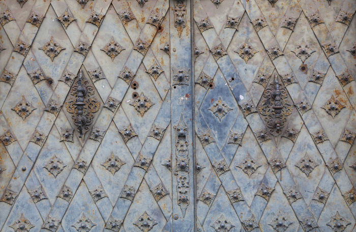 Old vintage antique medieval metal gate doors with forged decorative ornated elements Antique Architectural Detail Architecture Backgrounds Checkered Close-up Decoration Door Element Forge  Full Frame Gate Gothic Gothic Style History Iron Medieval Metal Metallic Ornate Pattern Religious Architecture Vintage