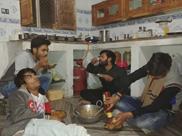 Candid Candid Photography Meeting Friends Indoors  Domestic Life Adult Mid Adult Lifestyles Togetherness Fun Celebration Party - Social Event Sitting Real People