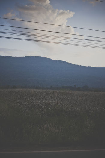 Thailand countryside Agriculture Beauty In Nature Blue Cable Calm Cloud - Sky Countryside Day Farm Landscape Majestic Mountain Mountain Range Nature No People Non-urban Scene Outdoors Power Line  Remote Rural Scene Scenics Sky Solitude Tranquil Scene Tranquility