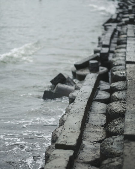 Air ALaM Beach Beauty In Nature Brick Brick Wall Central Java Close-up Day Element INDONESIA Lines Morning Nature No People Outdoors Pantai Rock Sea Side View Vibe Water Water Front  Wave