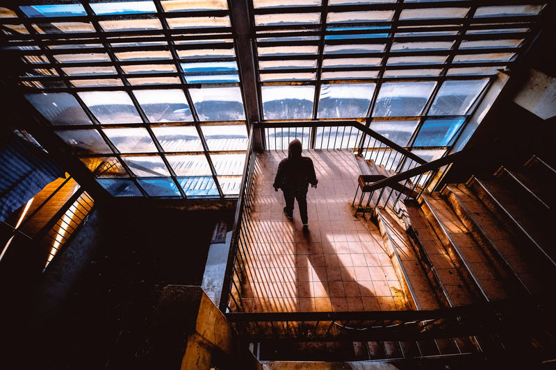 High angle view of silhouette woman on staircase