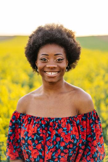Portrait of smiling woman on flowering field