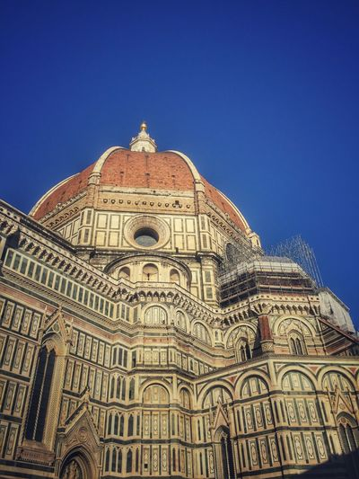 Low Angle View Of Duomo Santa Maria Del Fiore Against Clear Blue Sky