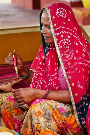 Mehndi Rasam Of India Aged Lady Indian Lady Stories In Faces EyeEm Best Shots Gpmzn Shot With A Leica Leica Photography. The Hues Of Rajasthan Indian Traditions Mehndi Art Bridal Mehndi Ceremony Ancient Indian Tradition Bright Dresses Traditional Occupations Bright Pink Odhni Sitting Men Working Cultures Pets Close-up Henna Tattoo Traditional Ceremony Indian Culture  Wedding Ceremony Hinduism