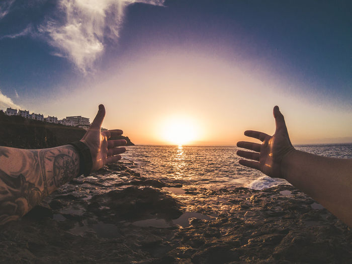 Beach Beauty In Nature Close-up Cloud - Sky Day Gopro Horizon Over Water Human Body Part Human Hand Lifestyles Low Section Men Nature Outdoors People Real People Scenics Sea Sky Sun Sunlight Sunset Water