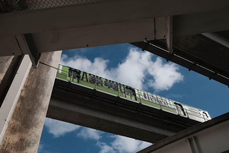 Commuter train Photographyisthemuse Commuter Train Monorail  Transportation Low Angle View Built Structure Architecture Sky Cloud - Sky Nature Day No People Outdoors Bridge Connection Sunlight