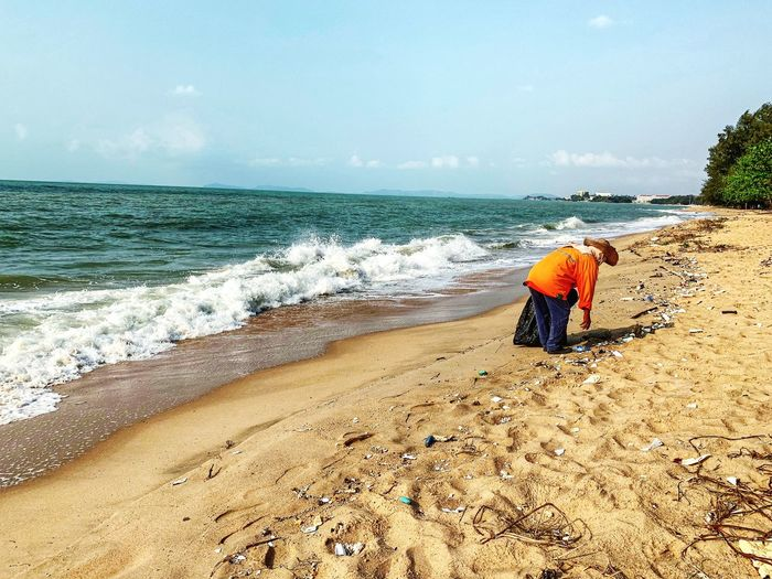 Trash keeper is cleaning the beach. Marine Debris Marine Litter Dumping Plastic Cleanup Ocean Environment Problem Pollution Rubbish Garbage Dirty Trash Beach Sea Water Land Sky Sand Beauty In Nature