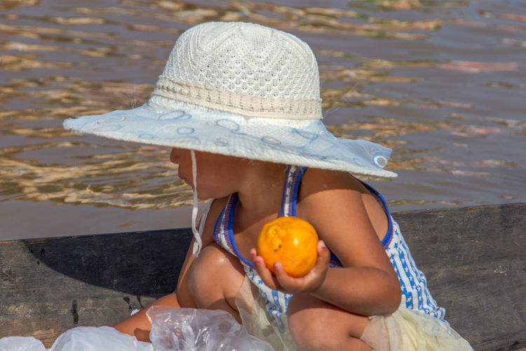 Young fruit seller hard at work...Hat Holding Nature One Person One Woman Only One Young Woman Only Sun Hat 3XSPUnity IMography Travel Photography My Point Of View Portrait Portrait Of A Woman Photographing Focus On Foreground Business Finance And Industry Nature Landscape_Collection EyeEmNewHere Art Is Everywhere Break The Mold TCPM Neighborhood Map