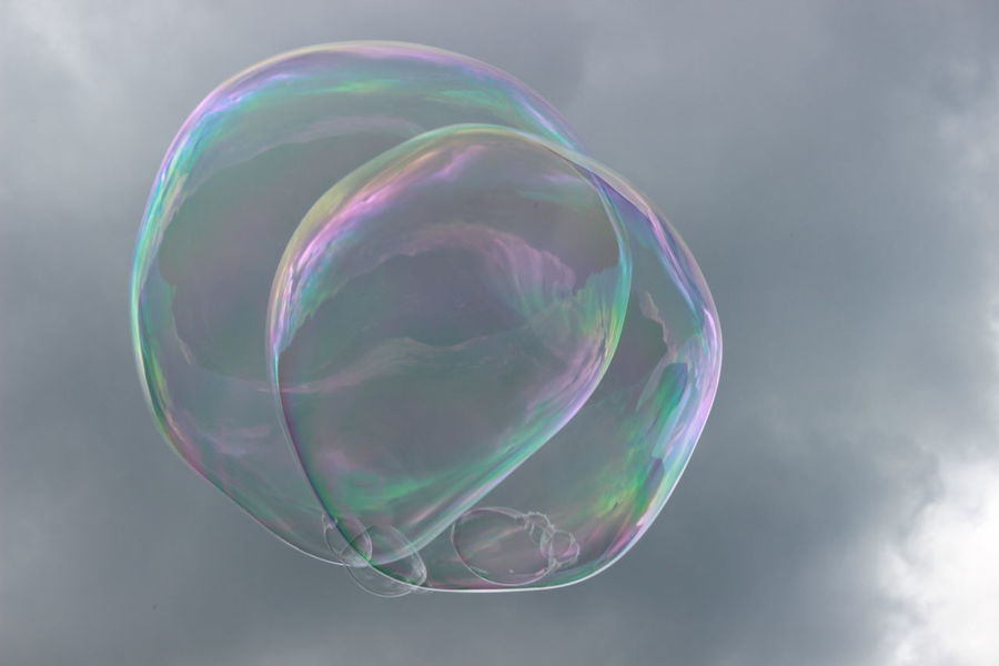 Dreams & Bubbles flying high Beauty In Nature Blowing Bubble Bubble Wand Close-up Cloud - Sky Day Double Rainbow Flying Fragility Lightweight Low Angle View Mid-air Multi Colored Nature No People Outdoors Rainbow Sky Soap Sud Spectrum