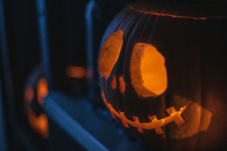 Close-up of illuminated pumpkin against black background