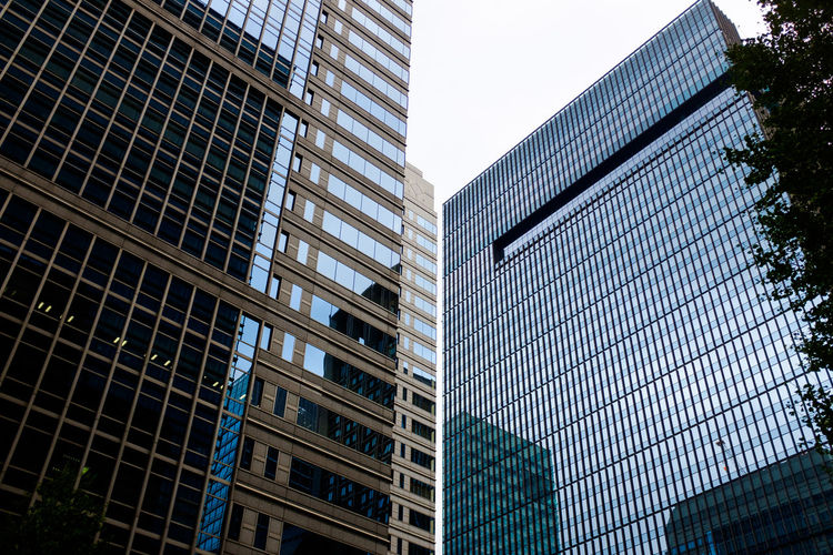 Architecture Building Exterior Built Structure City Day Downtown District Financial District  Low Angle View Modern No People Office Building Exterior Outdoors Sky Skyscraper